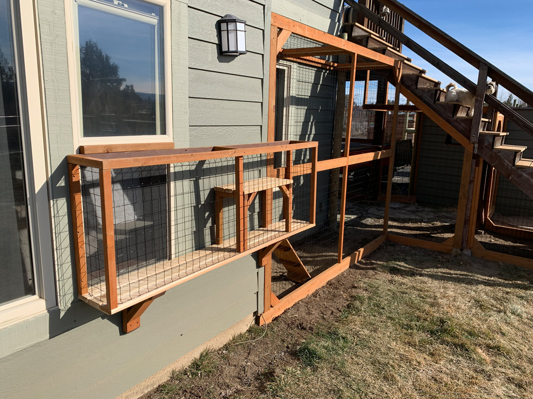 Deluxe catio cat enclosure built around the exterior corner of large house