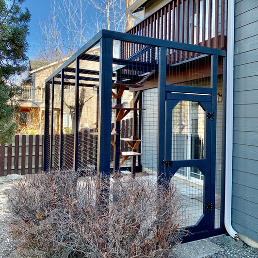 two story catio, with access tunnel from upstairs balcony, and painted in satin black
